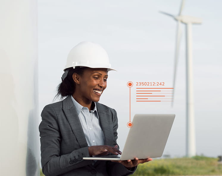 person in hard hat and suit jacket at computer