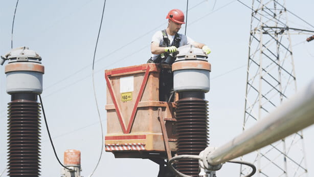 Person in cherry picker servicing electrical