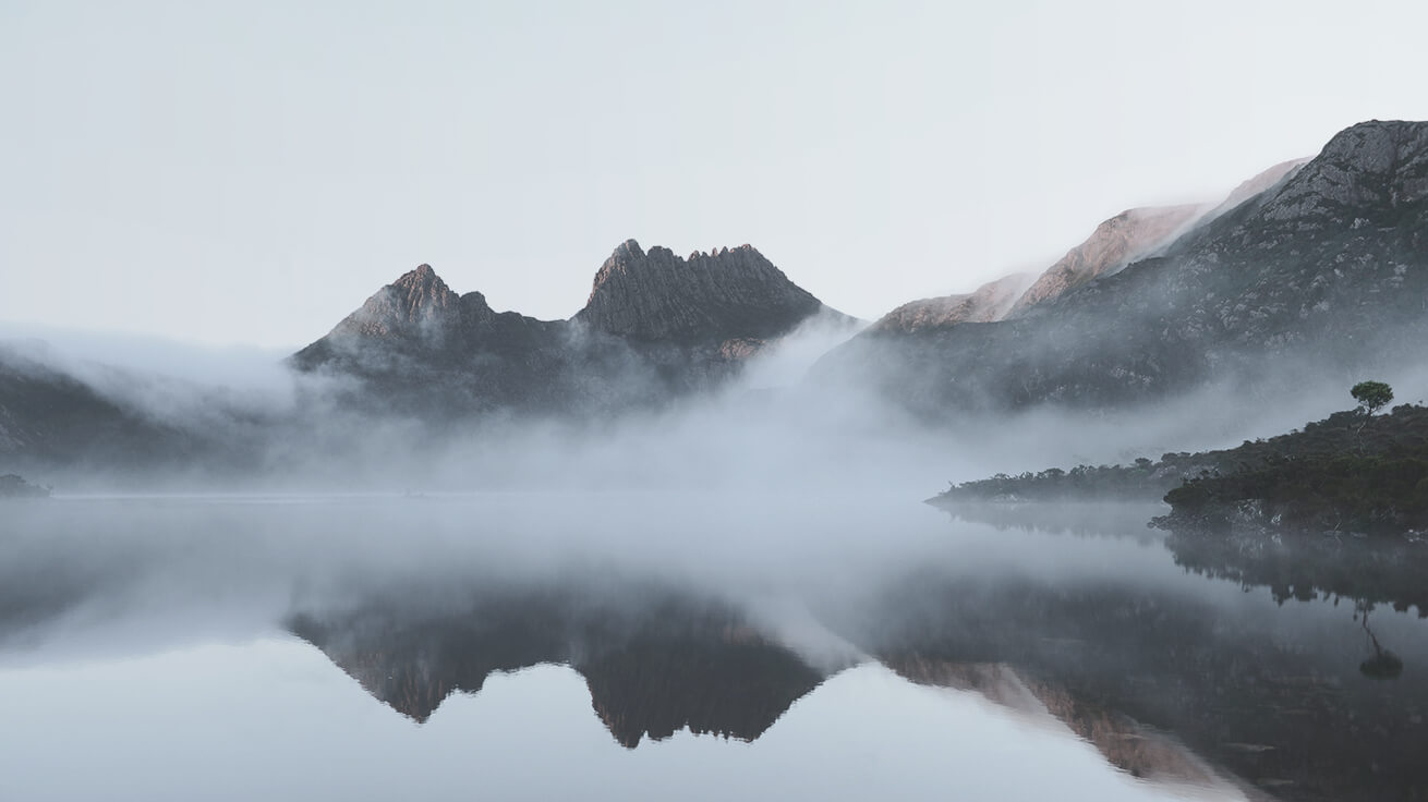 mountains reflecting in water